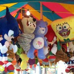 Plushy prizes hanging from a carnival booth